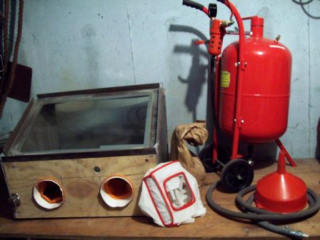 A collection of sandblasting equipment used for cleaning.