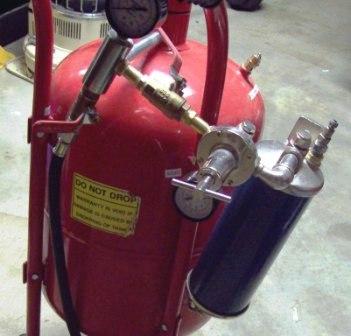 A 40 pound pressure pot sandblaster.