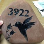 Engraved address on rock