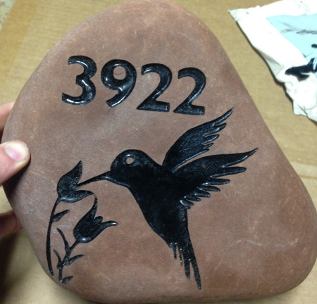 Engraved address on rock