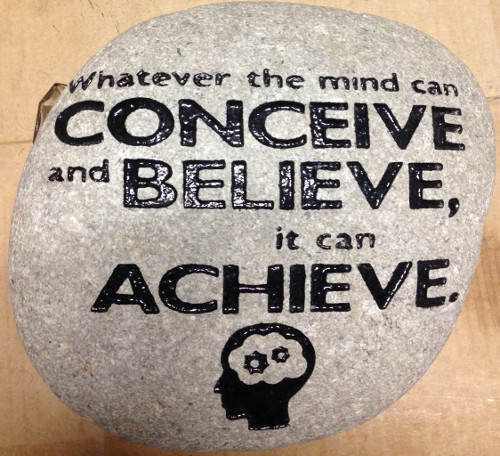 A garden rock sandblast engraved with quotes.