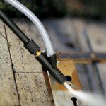 pressure washer sandblasting on metal